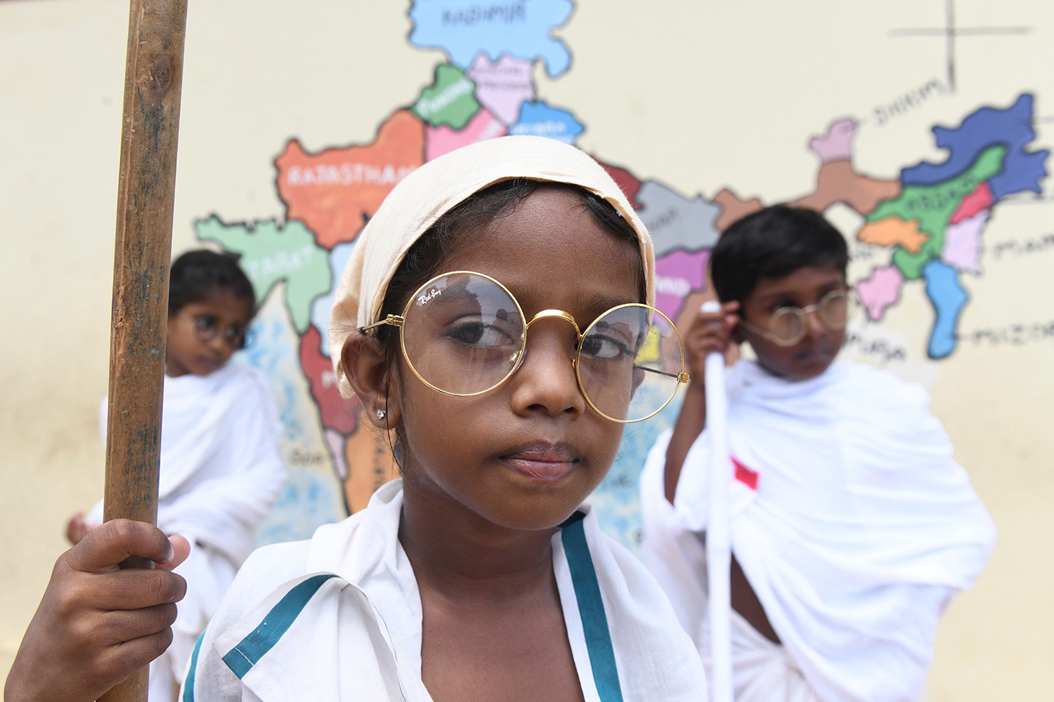 A student dressed like Mahatma Gandhi attends an event at a school in Chennai to mark the 150th anniversary of the Indian independence leader's birth on Oct. 2. ARUN SANKAR/AFP via Getty Images