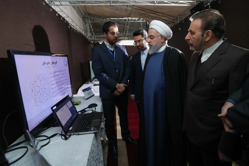 Iranian President Hassan Rouhani meets with Information and Communications Technology (ICT) Minister Mohammad Javad Azari Jahromi in Tehran during a visit to the exhibition area at the ICT Ministry on Jan. 21.