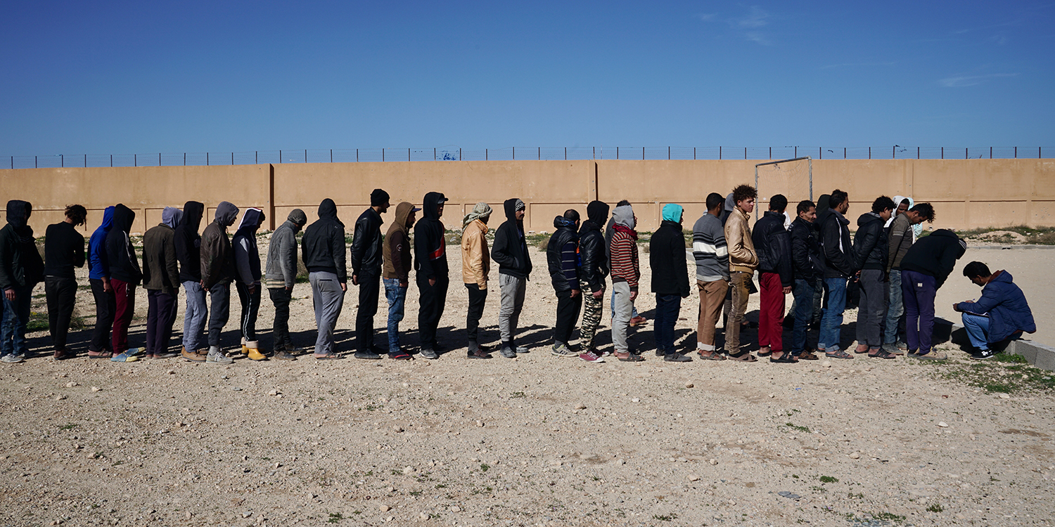 MIgrants wait in line for morning roll call at the Qunfudah detention center on Feb. 2.