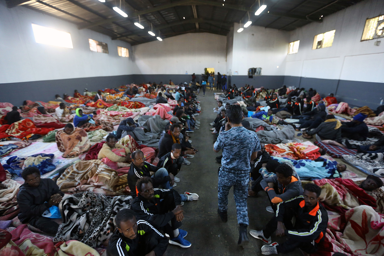 Migrants rest in a shelter at the Tariq Al-Matar migrant detention center on the outskirts of Tripoli on Dec. 11, 2017.