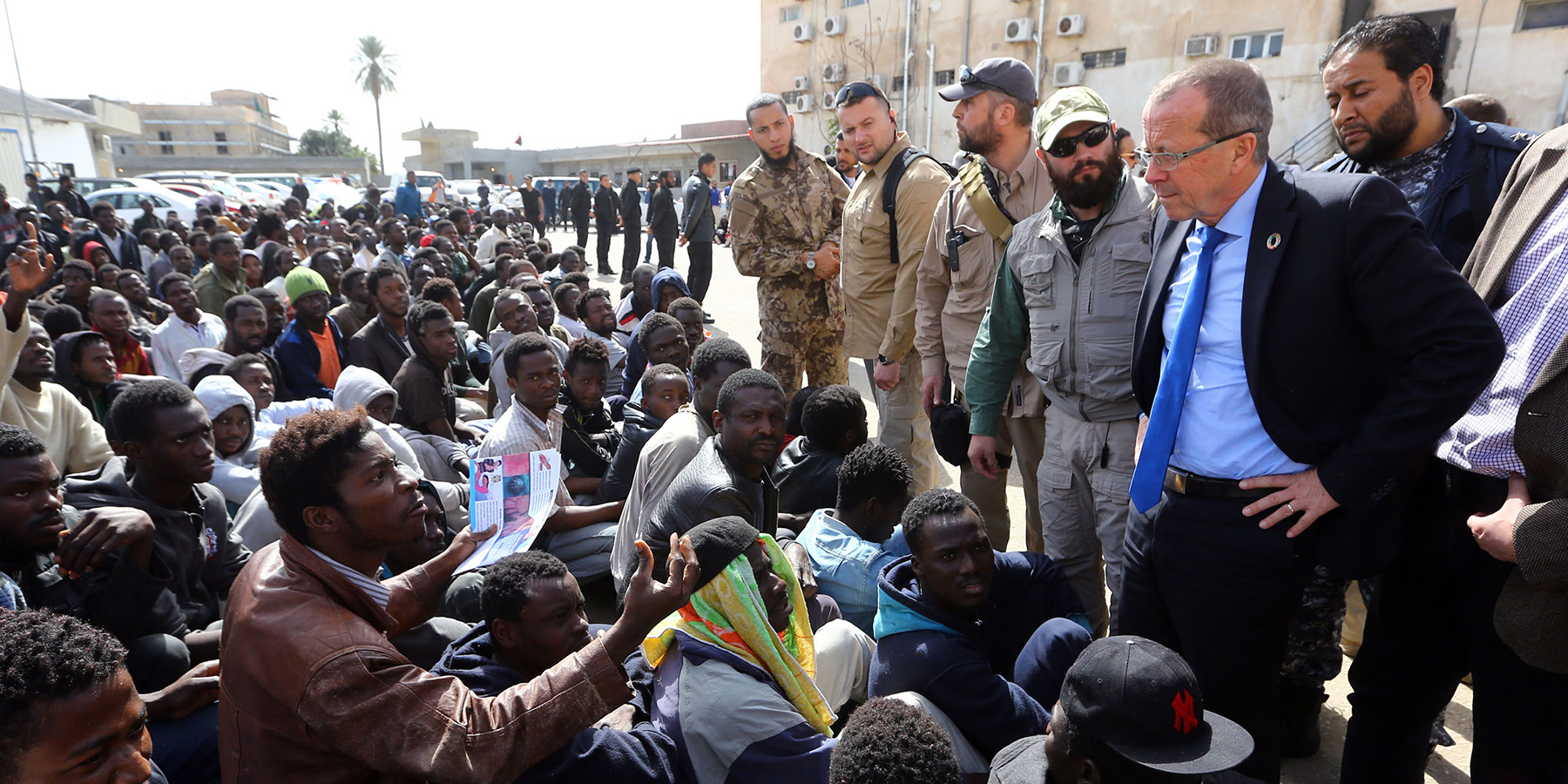 Martin Kobler, then the U.N. envoy to Libya, talks to migrants during a visit at a detention center in Tripoli on Feb. 17, 2017.