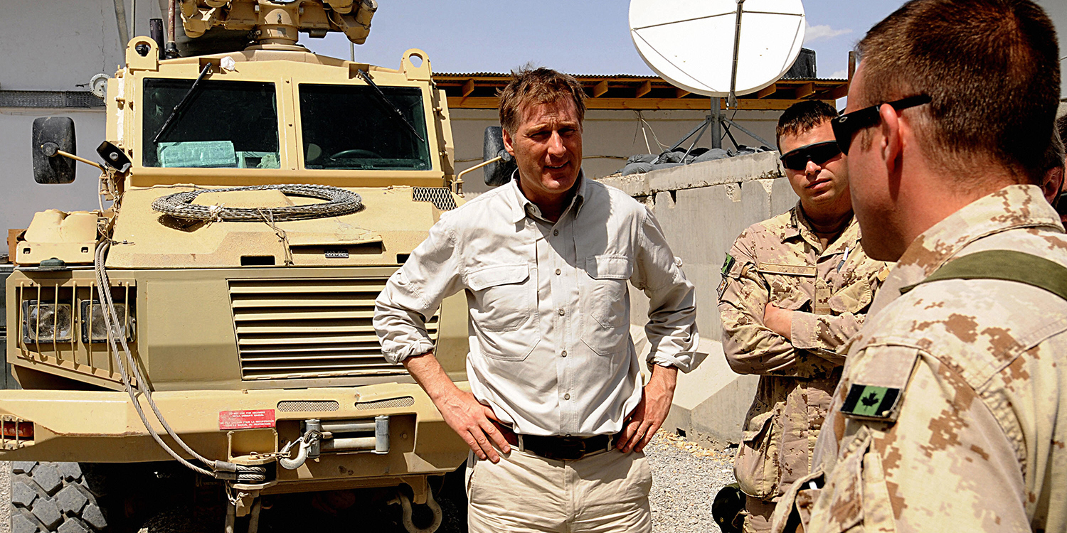 Bernier talks with Canadian soldiers with the NATO-led International Security Assistance Fprce in Kandahar province, Afghanistan, during a visit from the foreign ministers of France and Canada on April 13, 2008.