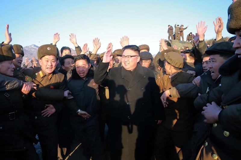 North Korean leader Kim Jong Un is surrounded by soldiers of the Korean People's Army as he inspects the test launch of a ballistic missile at an undisclosed location in a photo released by North Korea's official Korean Central News Agency on  Feb. 13, 2017.