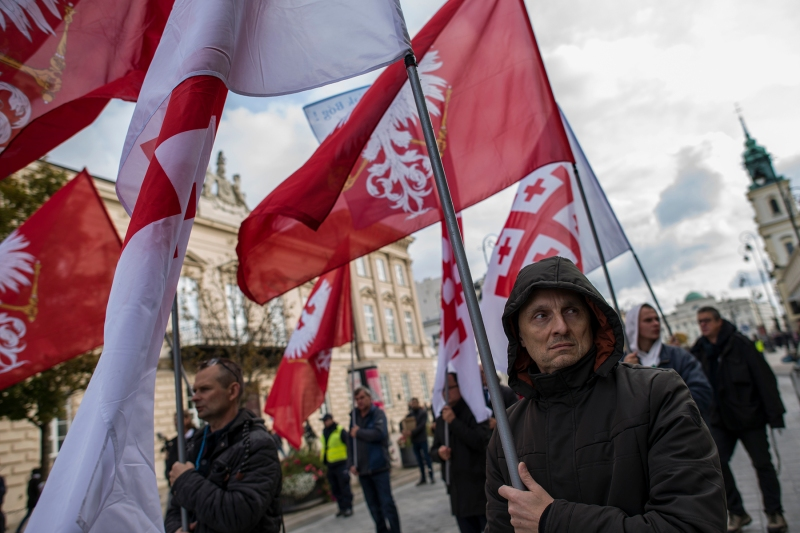 Participants seen holding flags during the National Rosary