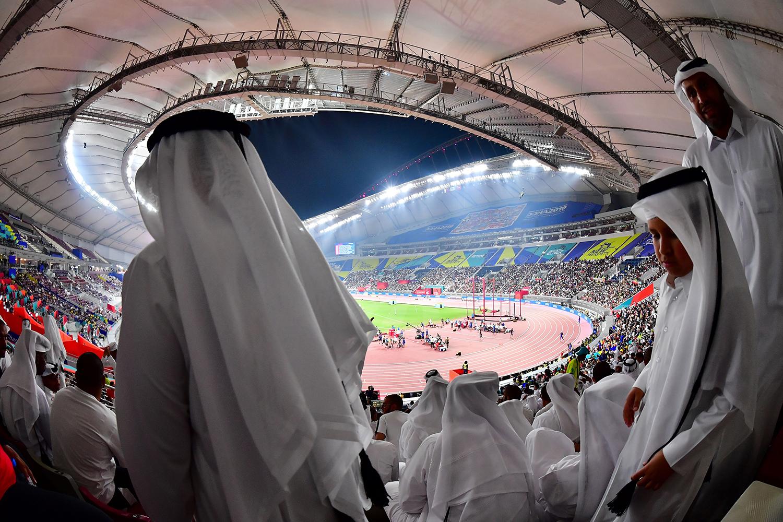 Spectators watch the IAAF Athletics World Championships at the Khalifa International stadium in Doha, Qatar, on Oct. 3. GIUSEPPE CACACE/AFP via Getty Images