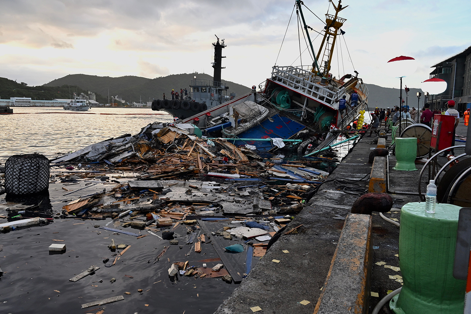 A fishing boat is seen smashed after a bridge collapsed in the Nanfangao fish harbour in Suao township, eastern Taiwan, killing at least four people on Oct. 2. SAM YEH/AFP via Getty Images