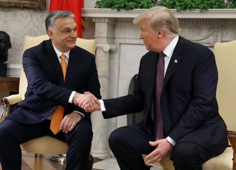 U.S. President Donald Trump shakes hands with Hungarian Prime Minister Viktor Orban during a meeting in the White House Oval Office in Washington on May 13.