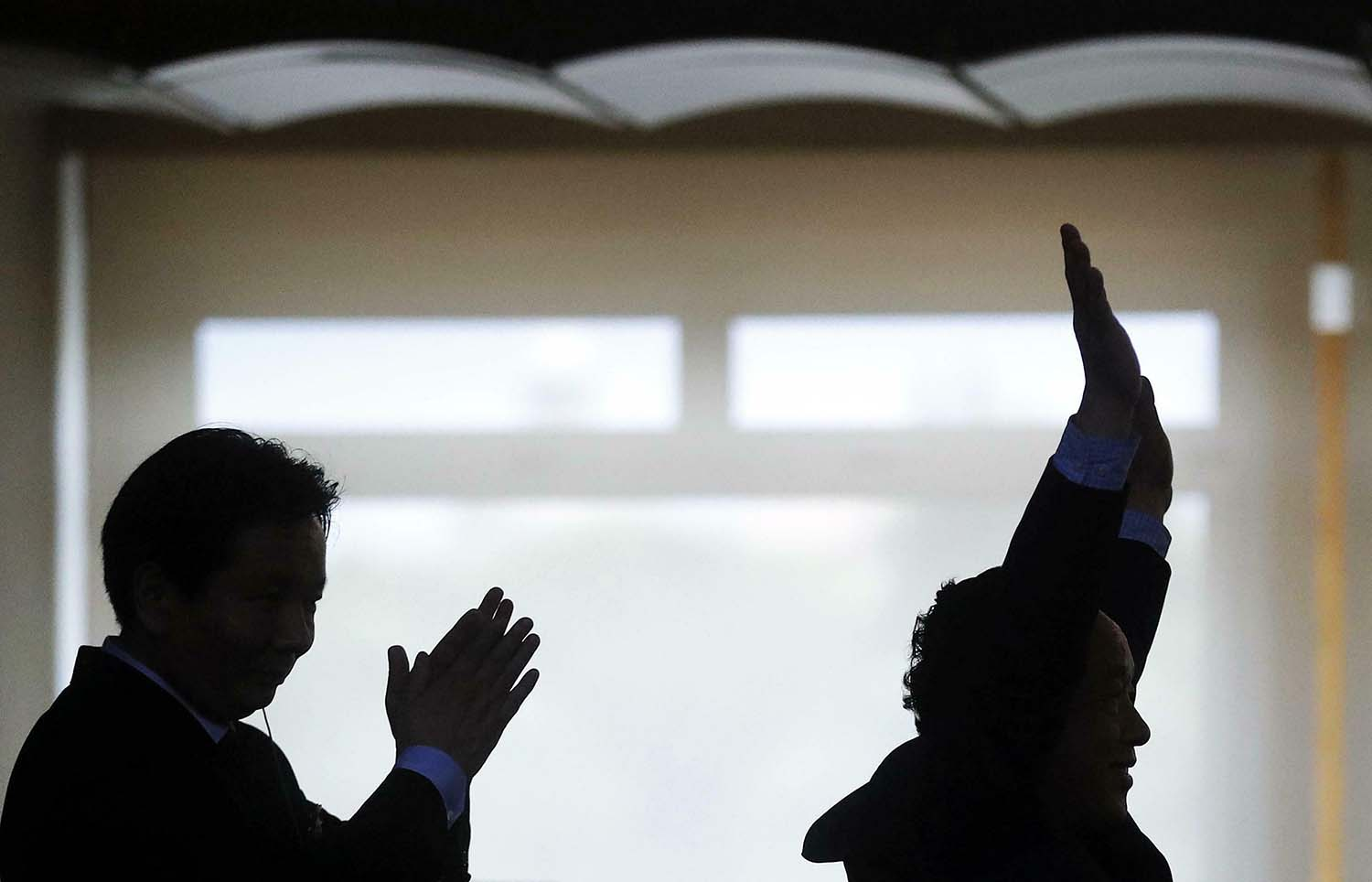 Qu Dongyu, right, celebrates after being elected as the new director general of the FAO in Rome on June 23.