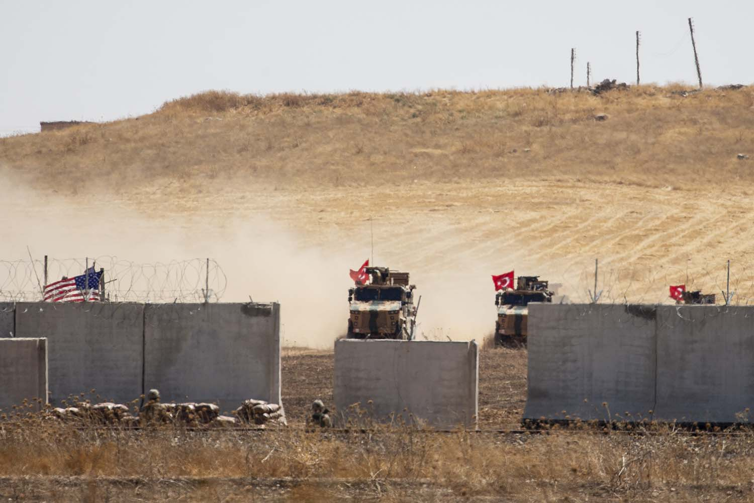 Armored vehicles from Turkey and the United States start their first joint ground patrols as part of efforts to establish a safe zone in Syria as seen from Turkey's Sanliurfa province on Sept. 8.