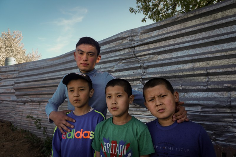 Seyil Eldos with his three younger brothers on the outskirts of Nur-Sultan, Kazakhstan, on May 17. Eldos's biological father died of a heart attack, and his mother married her husband's younger brother, as is traditional. Eldos's three brothers were born to the second marriage.