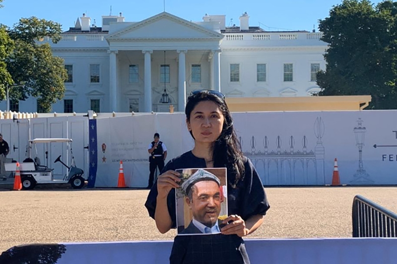 Nur Iman holds a picture of her father in front of the White House in Washington in September.