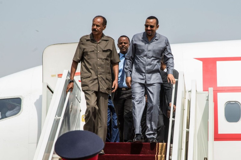 Eritrea's President Isaias Afwerki (L) and Ethiopia's Prime Minister Abiy Ahmed (R) disembark from an airplane upon arrival at Juba International Airport in South Sudan on March 4.