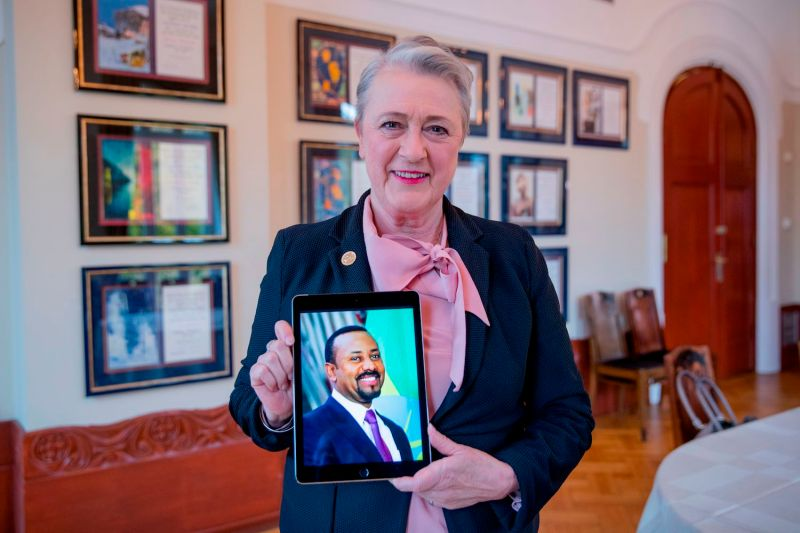 The chairwoman of the Norwegian Nobel Peace Prize Committee, Berit Reiss-Andersen, poses with a picture of Ethiopian Prime Minister Abiy Ahmed in the Nobel Institute in Oslo on October 11, 2019.
