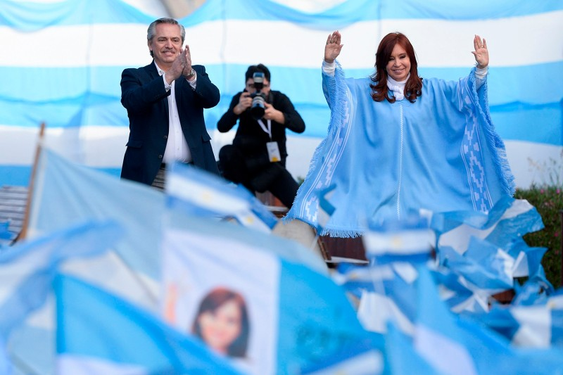 Argentine presidential candidate Alberto Fernandez and his running mate Cristina Fernandez de Kirchner greet supporters during the closing rally of their campaign in Mar del Plata, Argentina on Oct. 24.