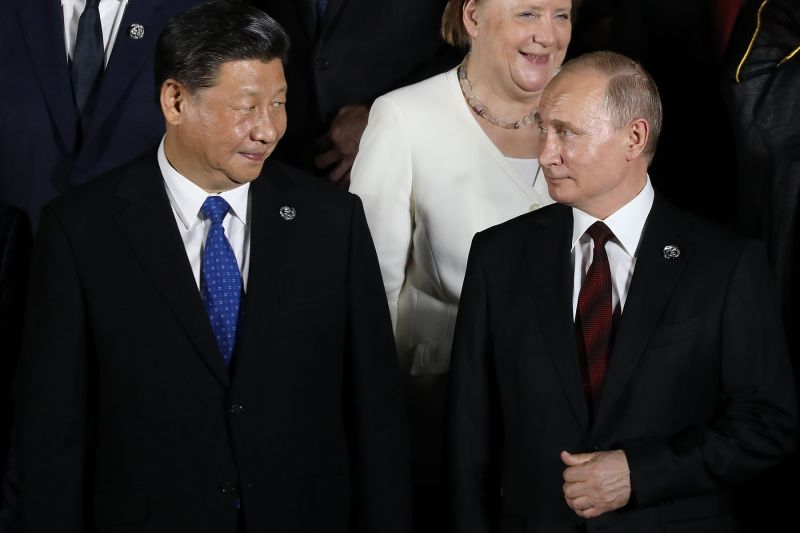 Chinese President Xi Jinping and Russian President Vladimir Putin at the G-20 summit in Japan.