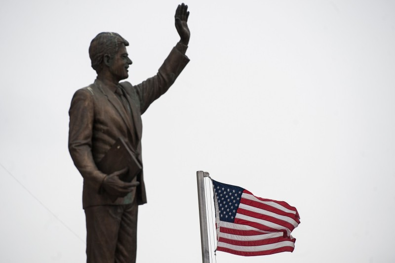 A U.S. flag flies next to the statue of former U.S. President Bill Clinton in Pristina, Kosovo, on Feb. 11, 2018.