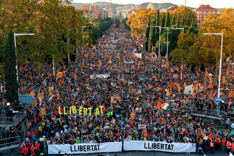 People march during a pro-independence demonstration against the conviction of Catalan separatist leaders in Barcelona on Oct. 26.