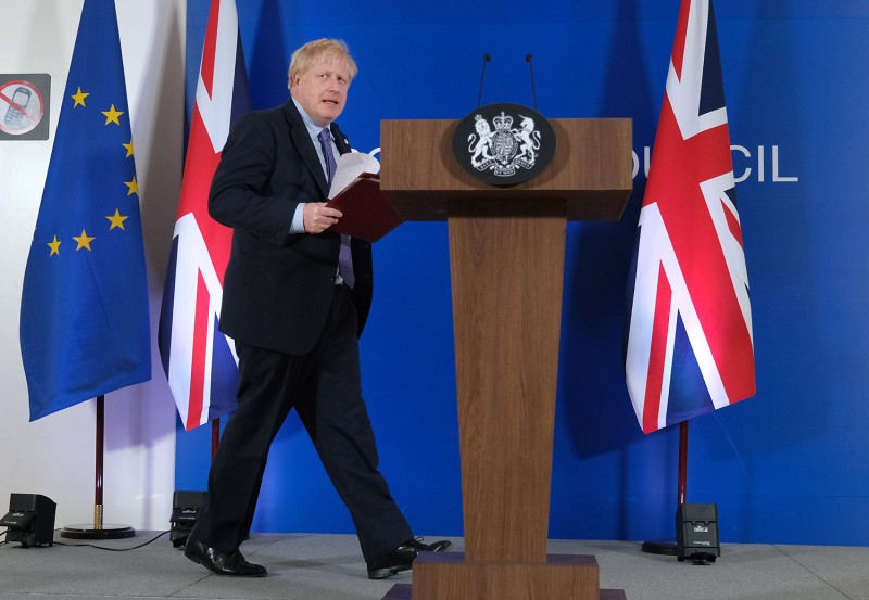 British Prime Minister Boris Johnson arrives to speak to the media during a two-day summit of EU leaders on Oct. 17 in Brussels.