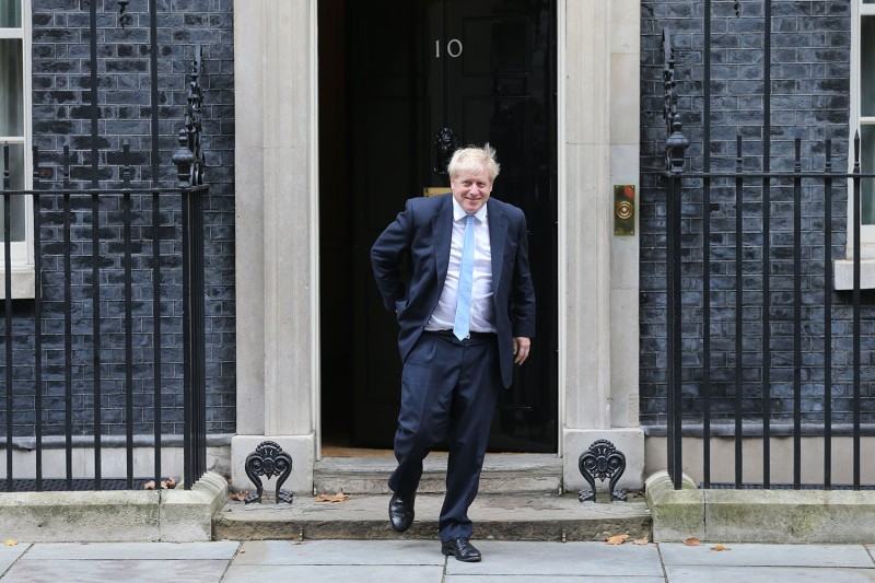 Britain's Prime Minister Boris Johnson comes out of Number 10 Downing Street in London on Oct. 15.