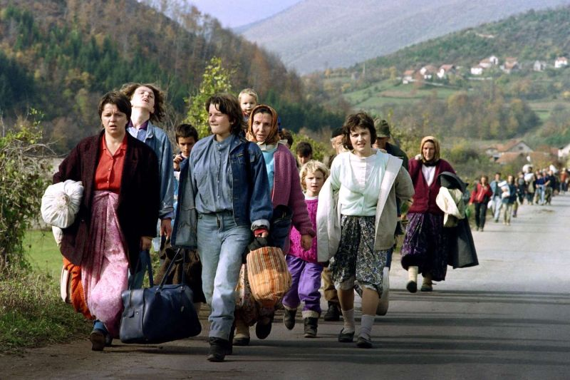 Bosnian women flee Jajce, Bosnia and Herzegovina, on Oct. 31, 1992.