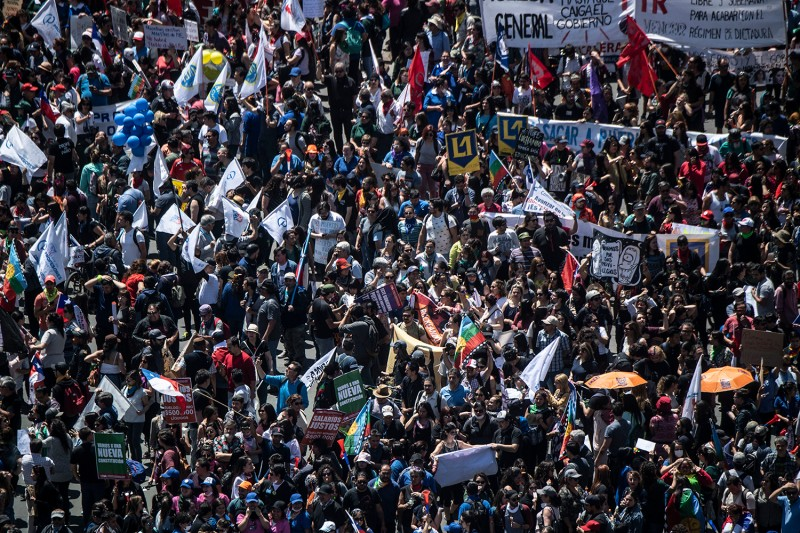 Anti-government protesters demonstrate in front of the presidential palace in Santiago, Chile, on Oct. 30.