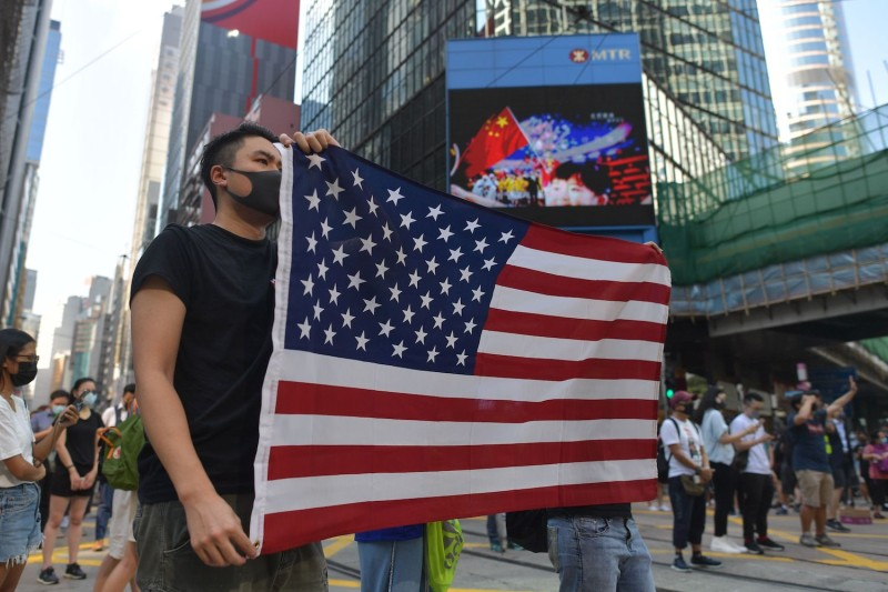 Protesters in Hong Kong display a U.S. flag.