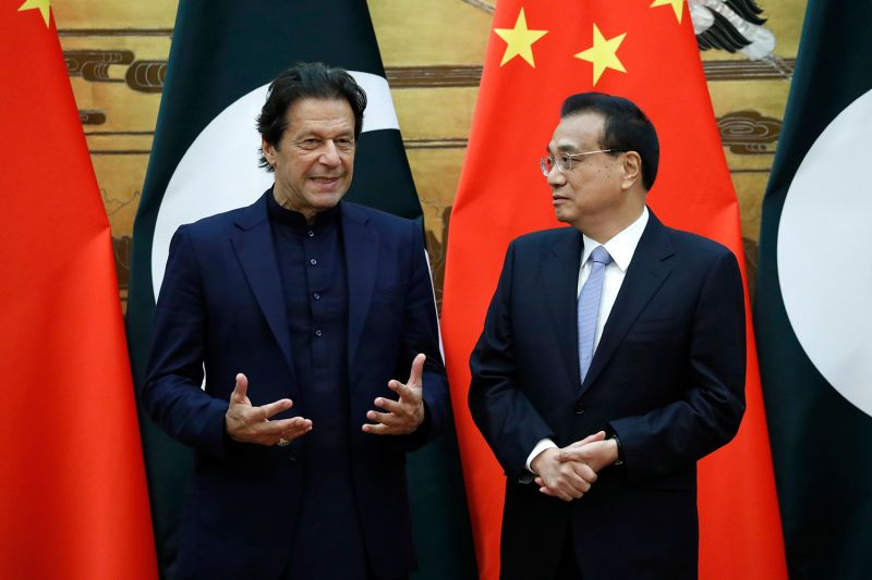 Pakistan's Prime Minister Imran Khan speaks with Chinese Premier Li Keqiang in Beijing.