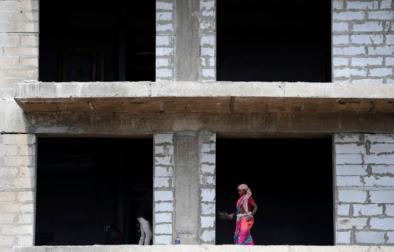 A laborer works at a construction site in New Delhi on Aug. 19.