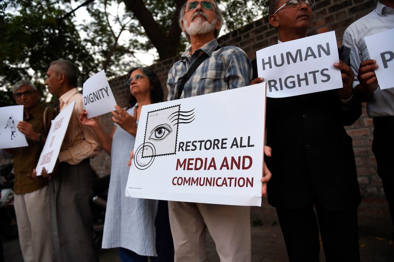 People participate in a peace rally to stand in solidarity with people of Kashmir in Ahmedabad, India, on Oct. 17.