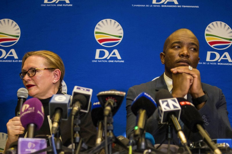 Mmusi Maimane (R), then the leader of the Democratic Alliance (DA) party, and the party's former leader, Helen Zille (L) give a press conference on June 13, 2017 in Johannesburg.