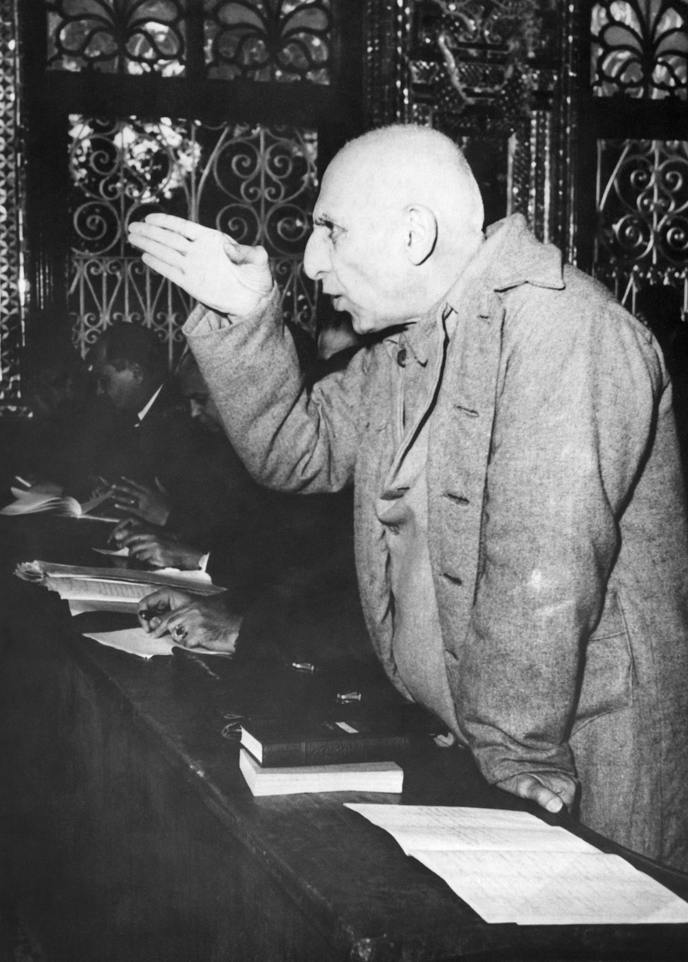 Iranian ex-premier Mohammad Mossadeq using his hand to make a point during court proceedings in Tehran's military tribunal, trying him for treason on Nov. 20, 1953.