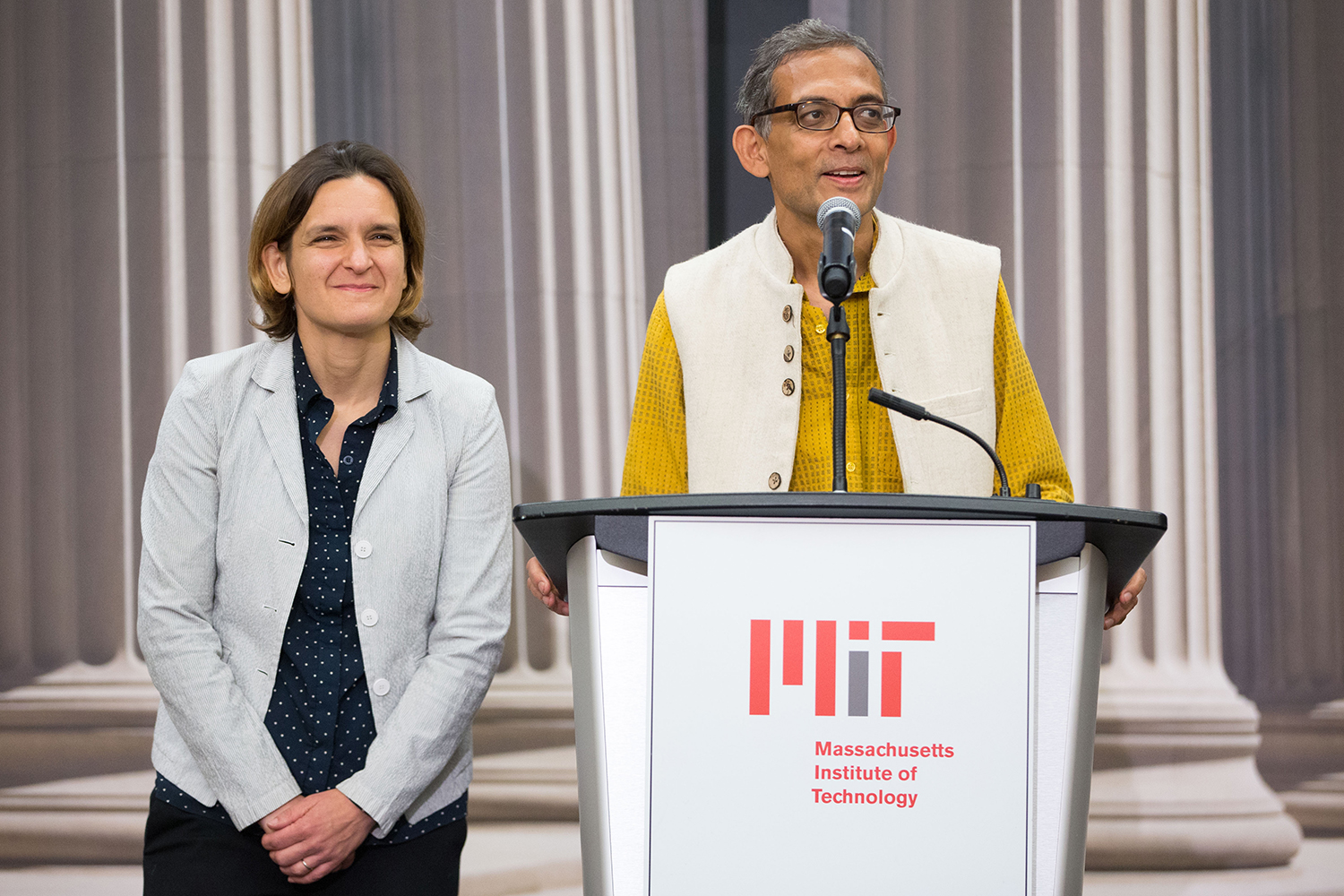 Esther Duflo and Abhijit Banerjee, who share a 2019 Nobel Prize in Economics with Michael Kremer, answer questions during a press conference on Oct. 14 in Cambridge, Mass.