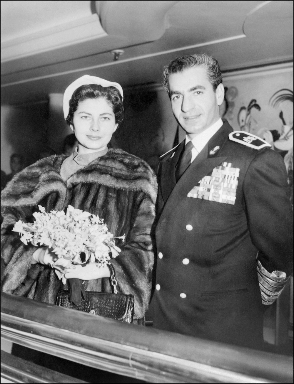 Mohammad Reza Pahlavi, the Shah of Iran, and his wife Empress Soraya pose for the media in Tehran in March 1953.