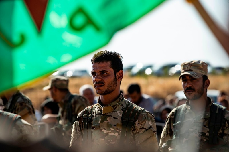 Mourners attend a funeral for Kurdish politician Hevrin Khalaf and others in northeastern Syria on Oct. 13.