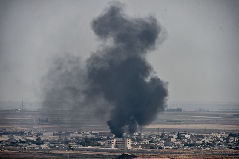 Smoke rises from the Syrian town of Ras al-Ain on the third day of Turkey's military operation.