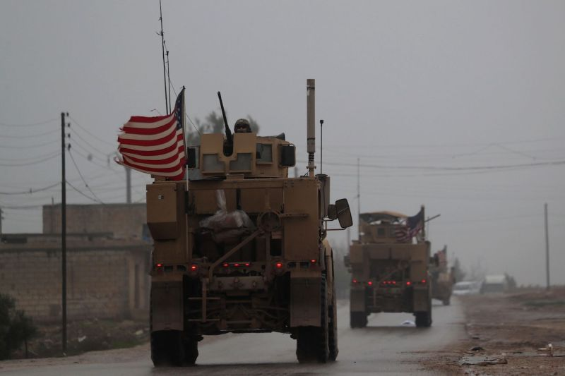 A line of U.S. military vehicles in Syria's northern city of Manbij on Dec. 30, 2018 after U.S. President Donald Trump first announced in  that U.S. troops would depart Syria.