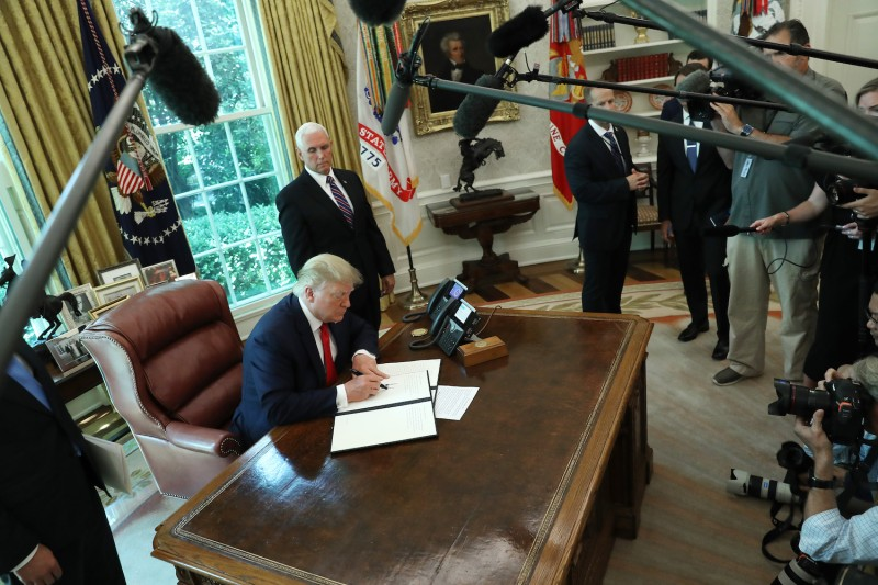 U.S. President Donald Trump signs an executive order on June 24, 2019, imposing sanctions on Iran.