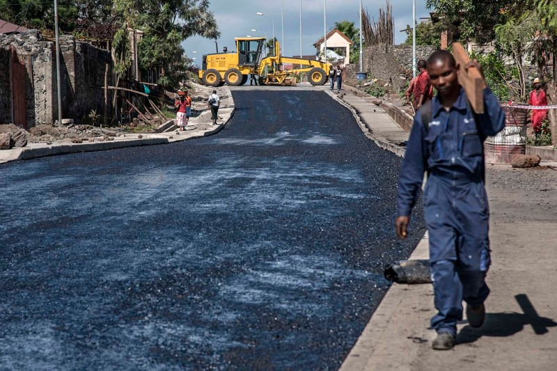 Workers construct a road in Goma, the main city in the eastern Democratic Republic of the Congo.