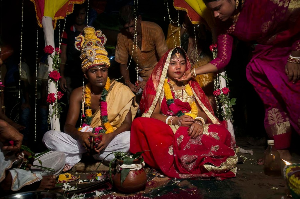 Mia, 15, sits with her new 27-year-old husband during their wedding in Bangladesh's Tangail district