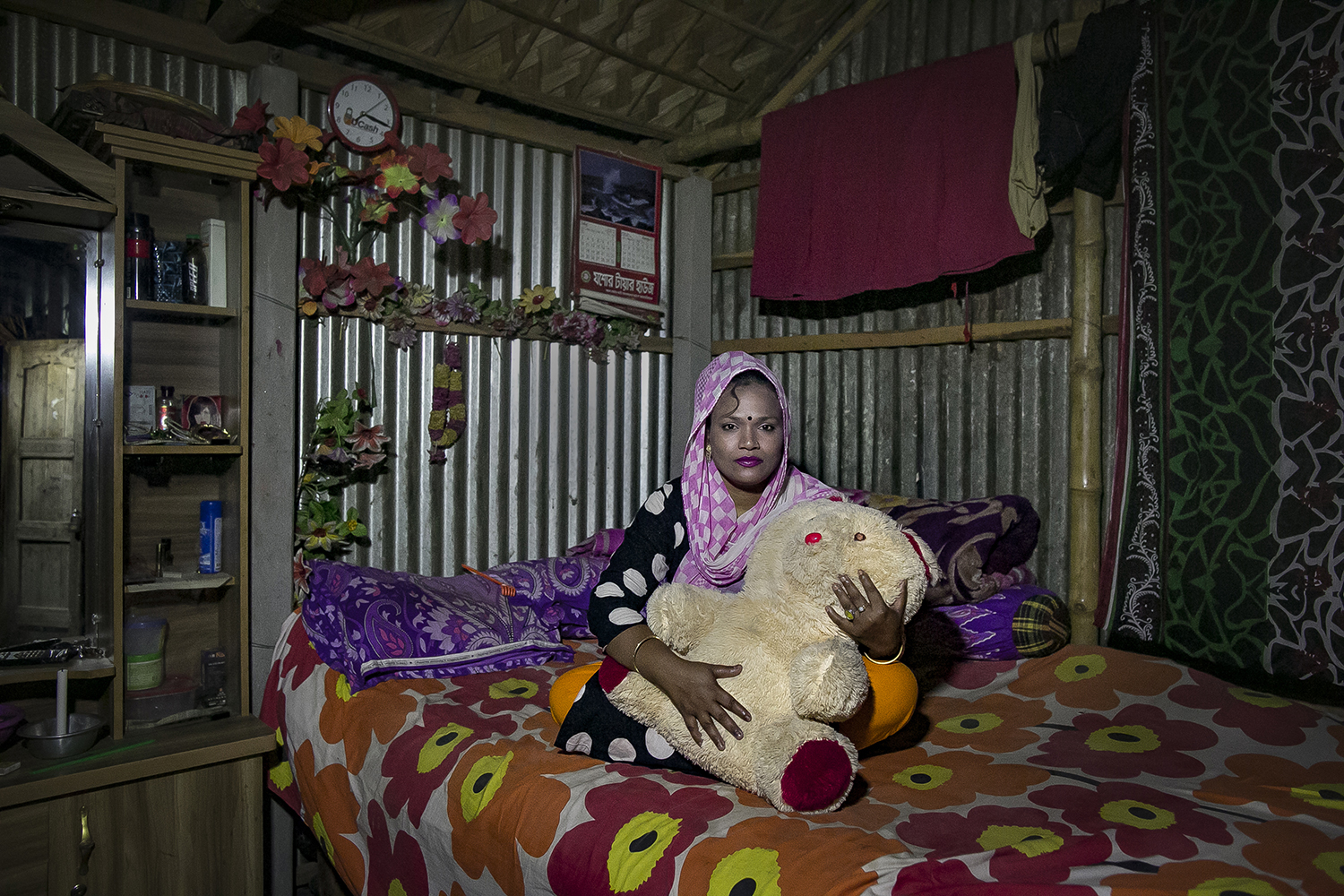 Hajera, who married at 12 before she was trafficked to the Kandipara brothel, sits in her room there on March 28, 2017.