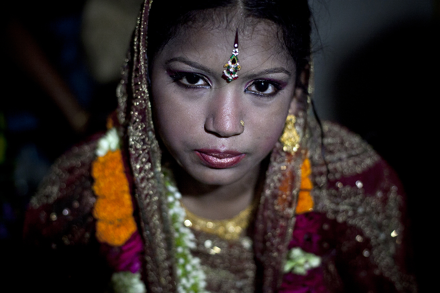 Thirteen-year-old Runa Akhter is seen the day of her wedding to a 29-year-old man in Manikganj, Bangladesh, on Aug. 29, 2014.