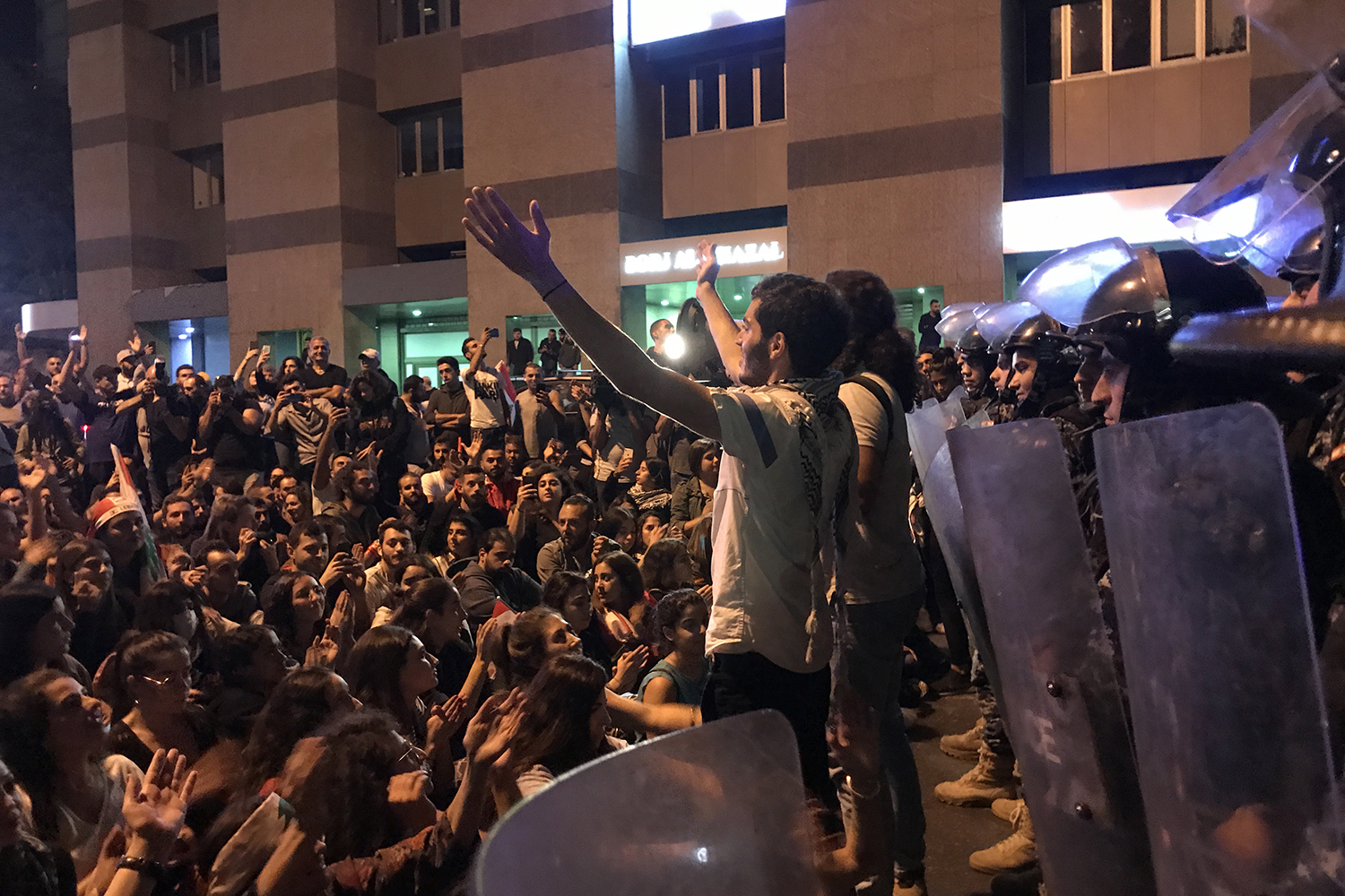 Ali Nourredine, a 25-year-old journalism graduate, leads a crowd of demonstrators blocking the Ring Road in chants, minutes before riot police attempted to disperse the roadblock on Oct. 31.