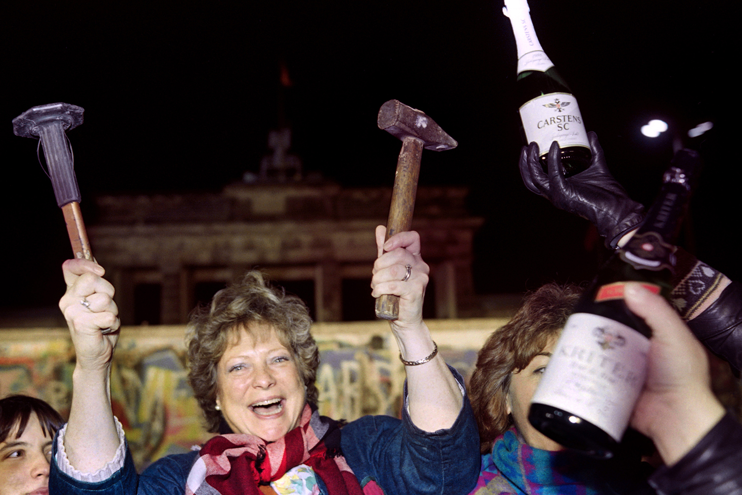 A Berliner holds up a hammer and a chisel in front of the wall on Nov. 15, 1989. Gerard Malie/AFP via Getty Images