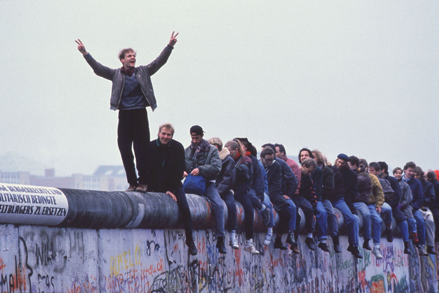 West Germans celebrate the unification of Berlin atop the wall on Nov. 12, 1989. Stephen Jaffe/Getty Images