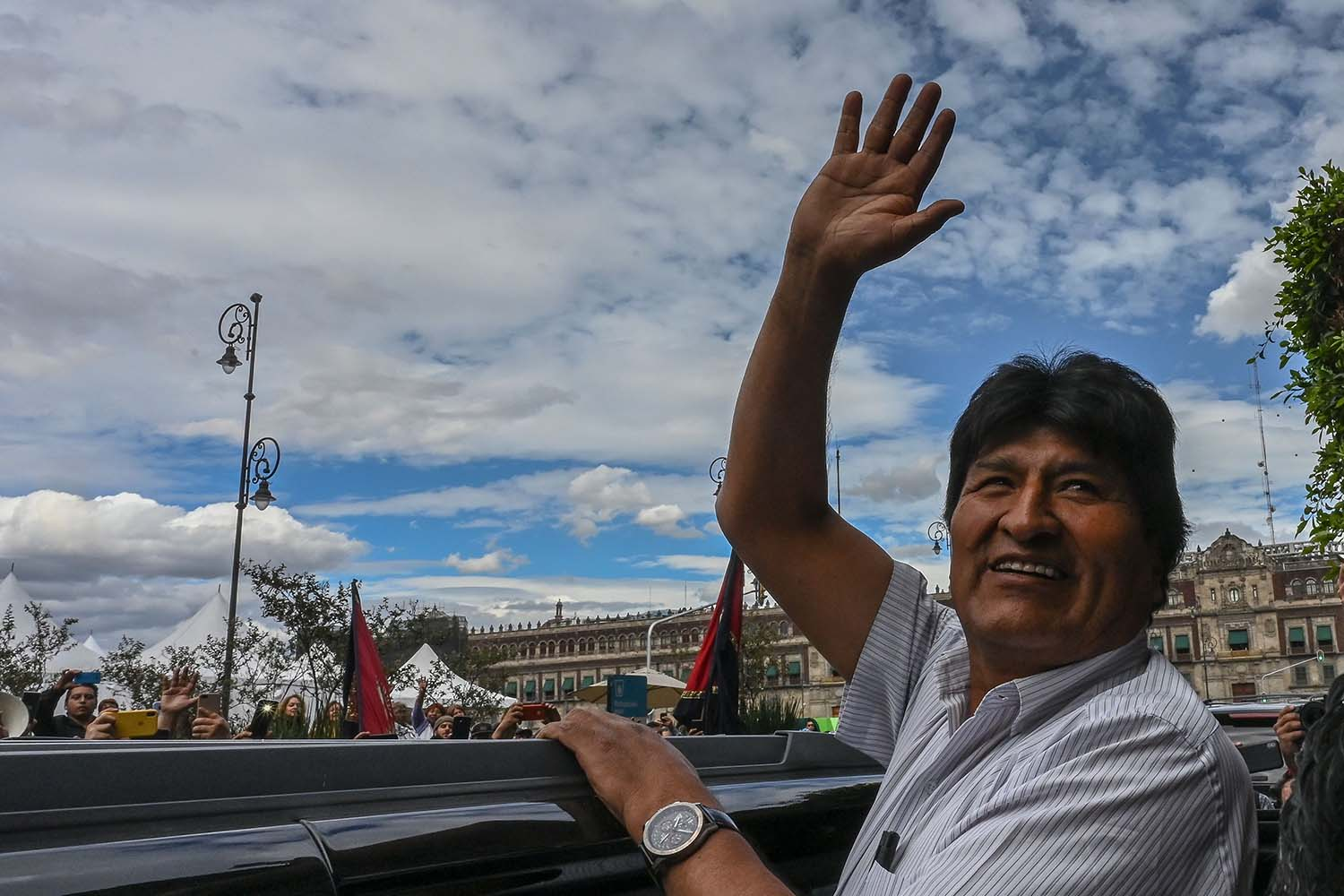 Former Bolivian President Evo Morales waves as he leaves the Historic City Hall where he was honored as a distinguished guest by Mexico City's Mayor Claudia Sheinbaum on Nov. 13. PEDRO PARDO/AFP via Getty Images
