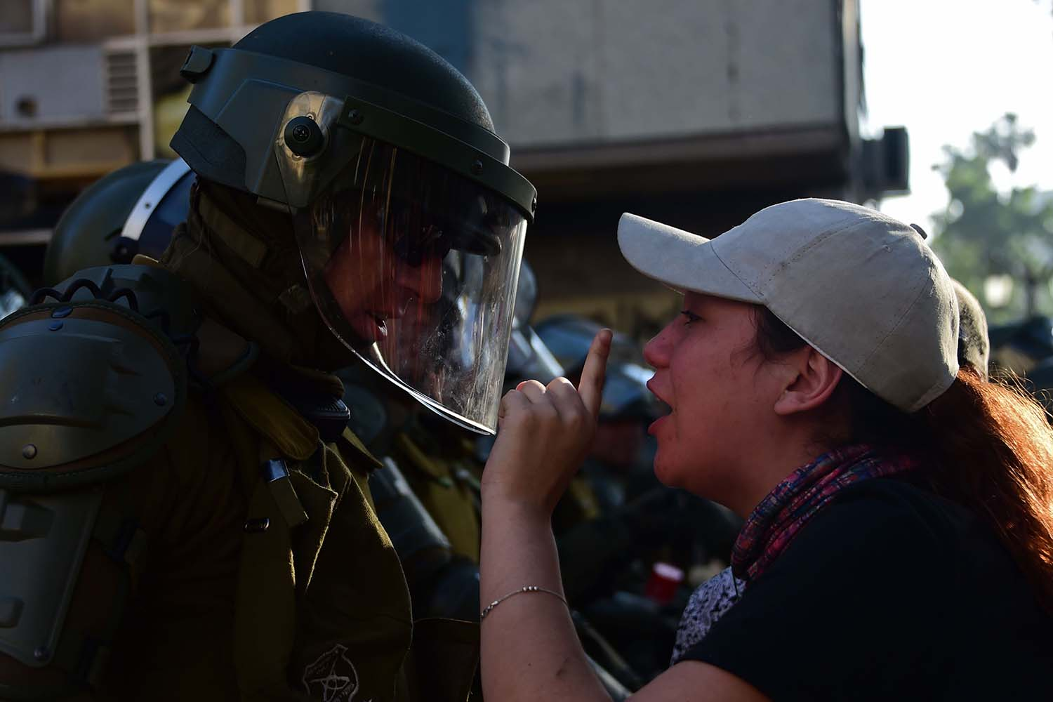 A demonstrator confronts a riot policeman during a protest in Santiago, Chile, on Nov. 13. JOHAN ORDONEZ/AFP via Getty Images