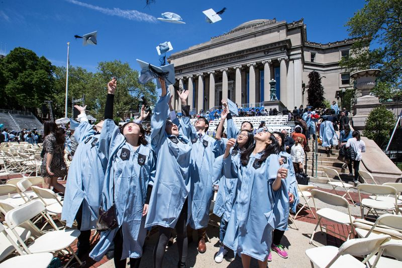 A group of Chinese graduates celebrate after the commencement ceremony at Columbia University in New York on May 18, 2016. Xinhua/Li Muzi via Getty Images