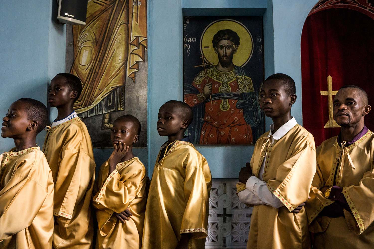 Congolese altar boys of the Greek Orthodox Church attend a Sunday Mass at the Saint Andrew Cathedral in Kananga on Nov. 10. JOHN WESSELS/AFP via Getty Images
