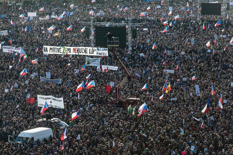 People attend a protest in Prague on Nov. 16. Huge crowds flooded central Prague demanding that Czech Prime Minister Andrej Babis step down over allegations of graft. MICHAL CIZEK/AFP via Getty Images
