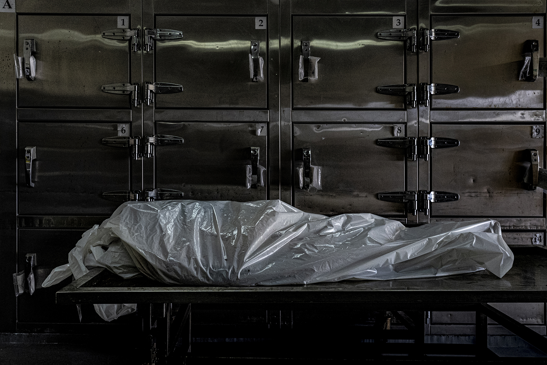 The body of Eduardo Castillo Calles, 54, nicknamed Limonada (Lemonade), lies in the autopsy room of the Institute of Legal Medicine in San Salvador on Oct. 4. He was a farmer and former soldier who formed a vigilante group to kill members of MS-13 near the El Tigre hamlet. Castillo Calles killed at least 15 members of MS-13, according to police, and they suspect his death was likely revenge from members of the gang.